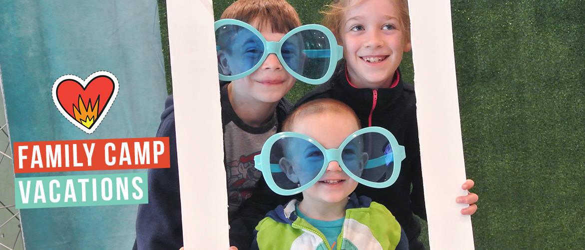 Three kids wearing big sunglasses